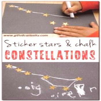 A fun constellation craft for kids using gold stars and chalk on black paper. This craft builds con