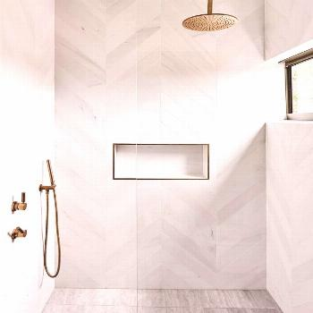 modern bathroom with modern white herringbone tile in walk in tile shower, white tile shower wiht g