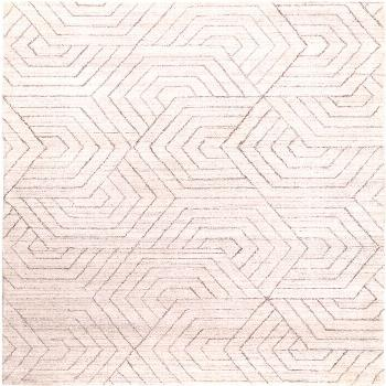 Overlapping hexagons give the neutral color pallet in this hand-loomed rug an unexpected twist. Sty