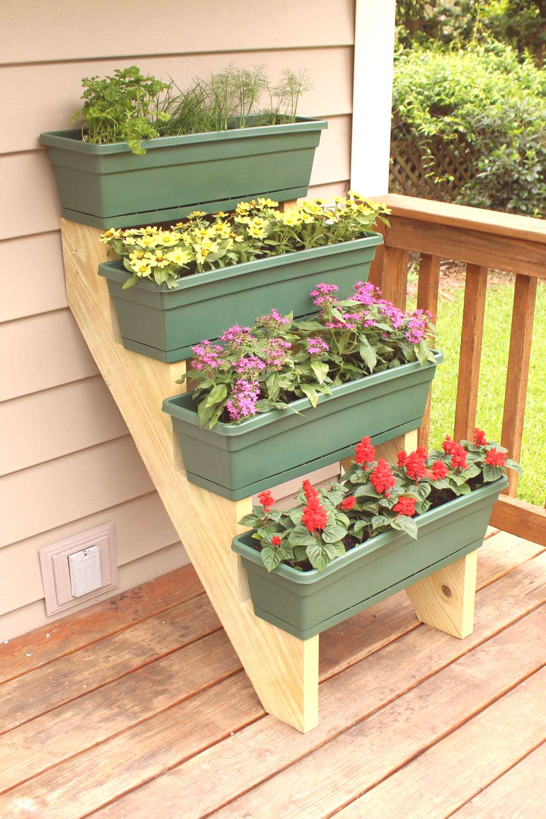 Heres an easy way to add some colorful plants to a small outdoor space by utilizing any vertical a