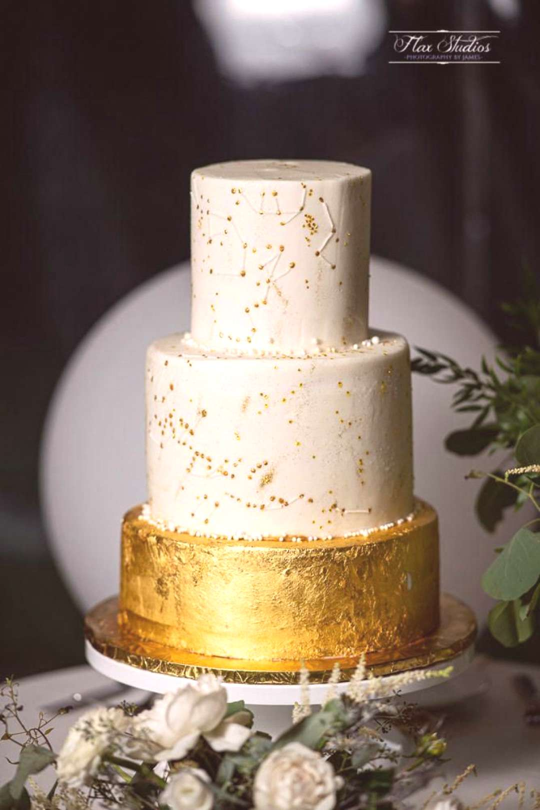 Star constellation wedding cake for those who love the night sky! Gold and white theme.
